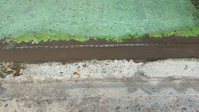 Edge detail at front of garage to form a very small ramp.